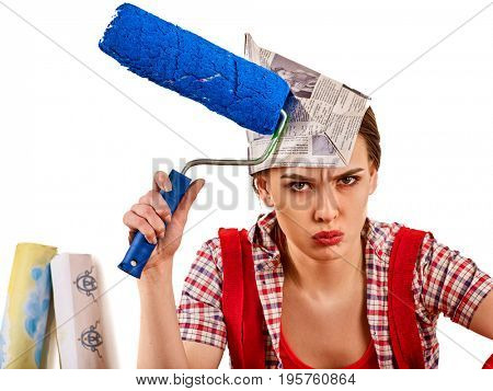 Repair home woman holding paint roller for wallpaper. Aggressive screaming girl in newspaper cap renovation apartment on isolated. Tired of work as a student.