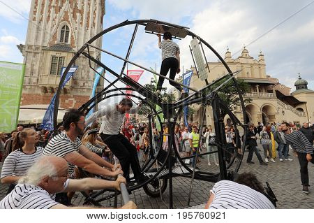 CRACOW POLAND - JULY 5 2017: 30th Street - International Festival of Street Theaters in Cracow Poland. An Odyssey Towards New Shores - a street parade
