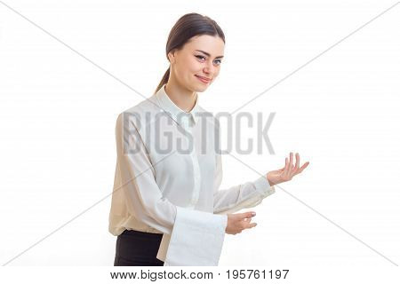Charming waitress in uniform posing in studio isolated on white background