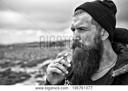 Man Hipster Or Guy With Beard And Moustache Smoking Cigarette