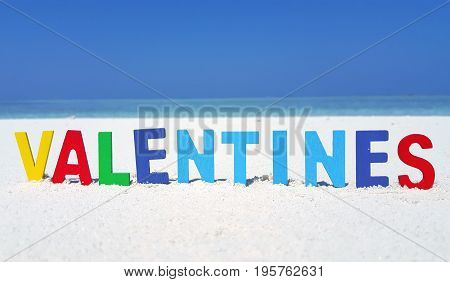 Maldives white sandy beach valentines text on sunny tropical paradise island with aqua blue sky sea ocean