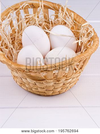 Eggs in basket on the white background