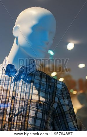 Showroom boutique mannequin with clothes on sale male figure portrait selective focus
