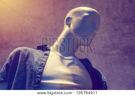 Boutique mannequin with clothes on sale male figure portrait selective focus