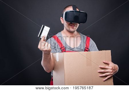 Mover Guy Holding Box And Credit Card Wearing Vr Glasses
