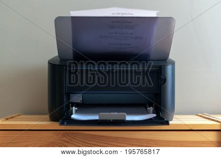Small office printer printing documents selective focus