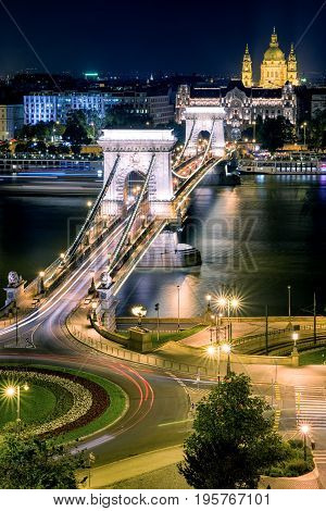 Famous Chain bridge Stephens basilica at night and river Danube in Budapest