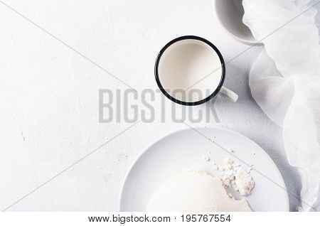 Fresh Homemade Cheese On A White Concrete Background