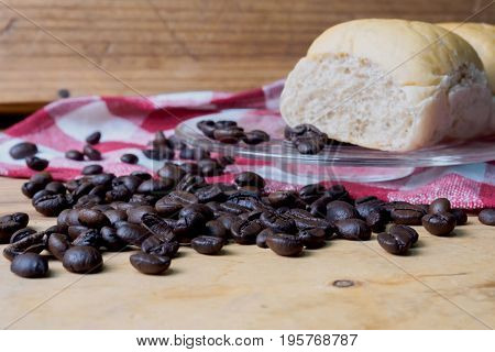 Coffee and bread wooden background on table