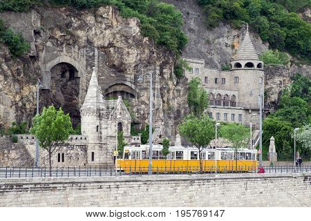 BUDAPEST HUNGARY - MAY 7: Yellow tramway and Gellert hill caves on May 7 2017 in Budapest
