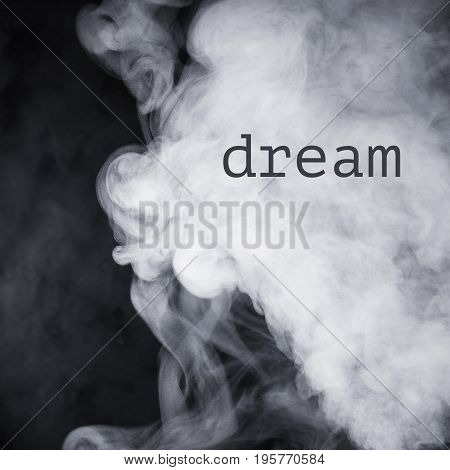 Inscription Dream on the abstract image of smoke.