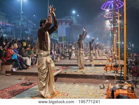 VARANASI, INDIA - JANUARY 3, 2016: Indian Brahmins conducts religious Ganga Maha Aarti ceremony (fire puja) at Dashashwamedh Ghat