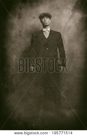 Antique Wet Plate Photo Of 1920S English Gangster Smoking A Cigarette. Wearing Suit And Flat Cap.