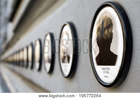 BUDAPEST HUNGARY - MAY 7: Photos of murdered people on House of Terror on May 7 2017 in Budapest