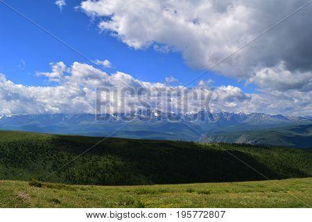 Snow peaks of North-Chuysky ridge and Kurai steppe in Altai mountains. Altay Republic Siberia Russia.