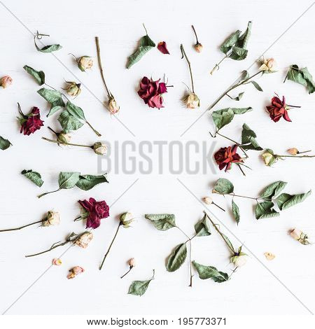 Frame made of dried rose flowers. Top view flat lay