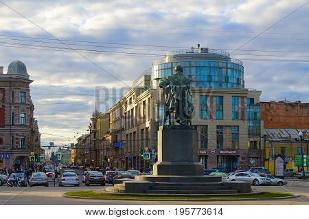 SAINT PETERSBURG RUSSIA - MAY 3 2017: Unknown people walk along Zagorodny prospect and Gorokhovaya street. Monument to A.S. Griboyedov in evening sunset light St. Petersburg Russia