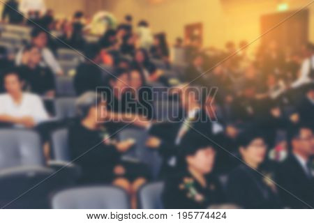 Blurred Image Of Business Conference And Presentation With Public Presentations. Audience At The Con