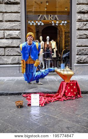 FLORENCE, ITALY - MARCH 27: Street performer dressing as Genie and the Magic Lamp on a street in Florence, Italy on March 27, 2015