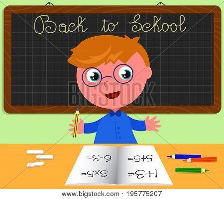 Cute boy at school desk in classroom. On the black board is written Back to school Cartoon vector illustration