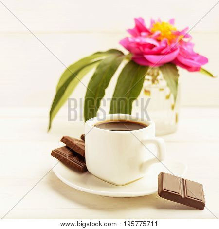 A Cup Of Coffee With Chocolate And One Flower In Vase On White Background, Toned Phot