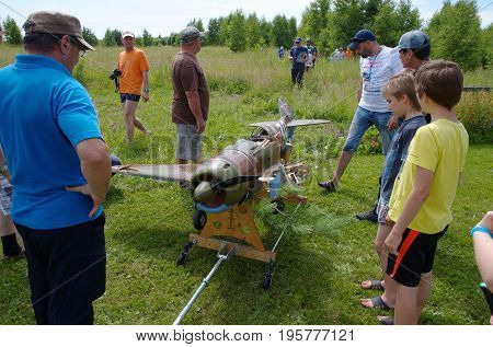 Penza Oblast, Russia - July 15, 2017: Radio control flying model of a soviet fighter World War II era, after collision. The Russian Aeromodelling Cup in Bolshoy Vyas village.