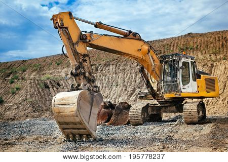 Industrial Heavy Duty Excavator Loading Soil Material From Highway Construction Site