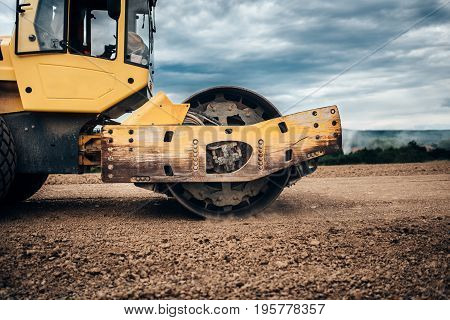 Close Up Details Of Industrial Road Soil Compactor, Vibratory Roller And Heavy Duty Machinery During