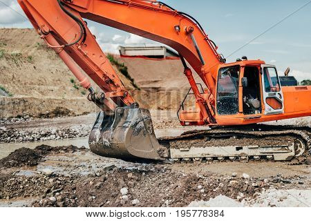 Heavy Duty Industrial Excavator Working During Earthmoving Works At Highway Construction Site