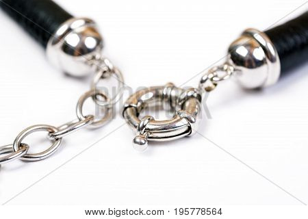 Lock of accessories of a leather bracelet isolated on white background