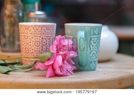 Street cafe. Cozy outdoor cafe with two cups and flower