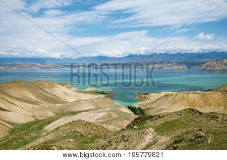 Toktogul  highland mountain lake in Kyrgyzstan, Jalal-Abad Province