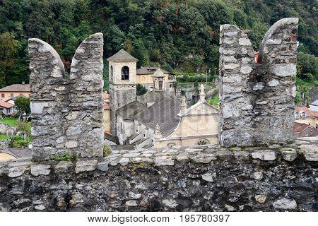 Bellinzona, Switzerland - 3 August 2015: The Collegiate Church and fort Castelgrande at Bellinzona on the Swiss alps Unesco world heritage