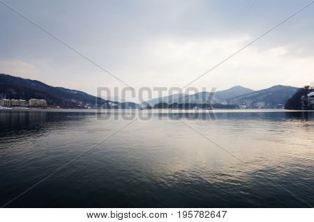 Beautiful lake view with the mountain landscape and cloudy sky