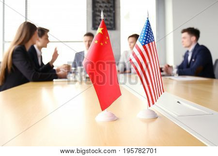 Diversity people talk the international conference partnership. Chinese flag and American flag