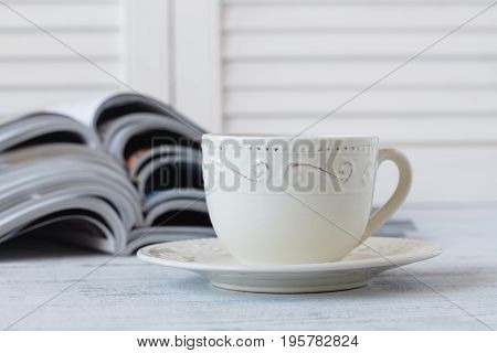 Cup Of Coffee With Magazines On Wooden Background