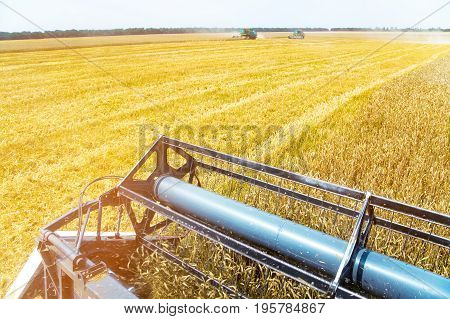 View from the cab of a combine harvester on field