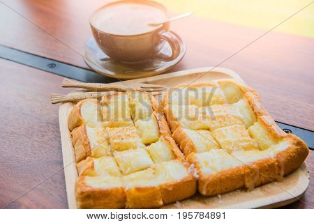 Bread and coffee set food and drink on wooden table in coffee shop at morning  .