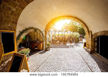 Street view under the church on the Merchants bridge in Erfurt, Germany