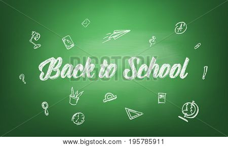 Back to school. Blackboard with chalk written typography back to school and hand drawn chalk scetches. Green blackboard