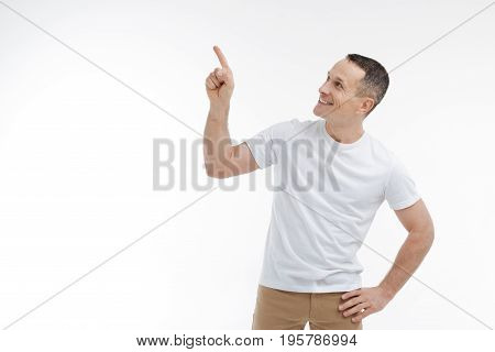 It is there. Enigmatical man putting left hand on the belt and expressing positivity while looking aside