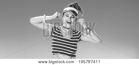 Smiling Woman On Seacoast With Headphones Listening To Music