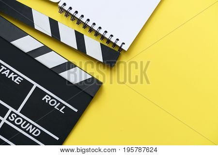 movie clapper on yellow background top view