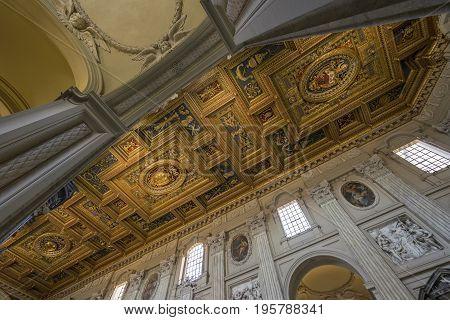 Basilica di San Giovanni in Laterano (St. John Lateran basilica). The ceiling with gold details. Italy Rome June 2017