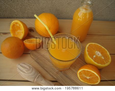 Freshly squeezed orange juice on a rustic table.