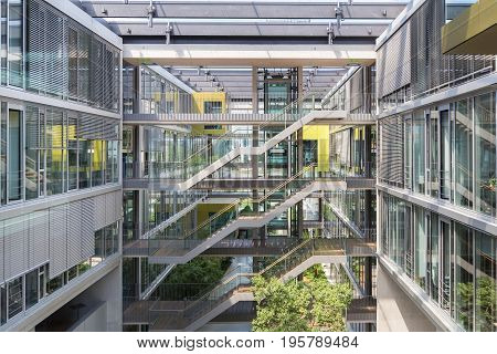 Main hall, staircase and windows of morden office building. Contemporary corporate business architecture.