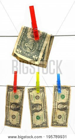 dollar on the line with clothes peg