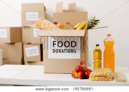 Packed with care. Charity organization collecting donations and storing them in their office while preparing packages for shipment