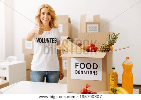 For the sake of community. Stunning generous amazing lady working for charitable organization and packing food for shipping it to those in need