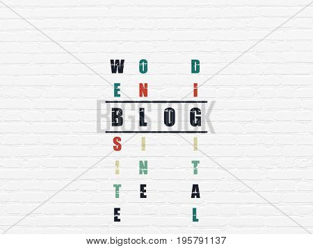 Web design concept: Painted black word Blog in solving Crossword Puzzle